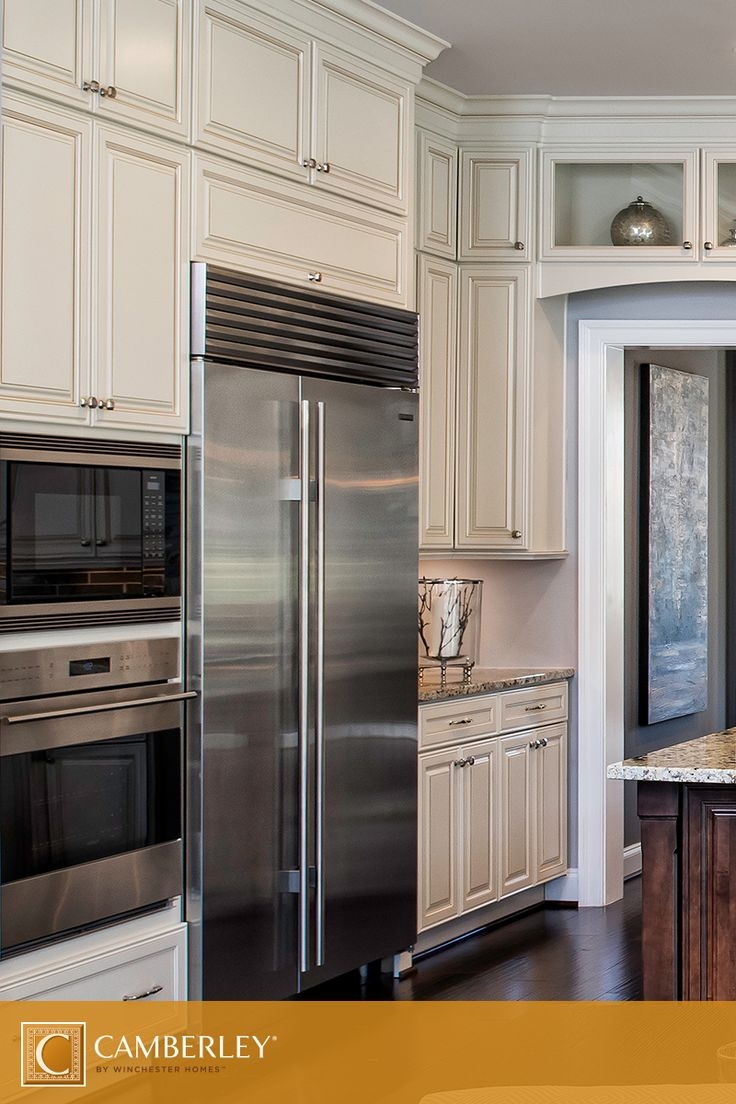 Stainless steel appliances such as a french door refrigerator and a  built-in double oven