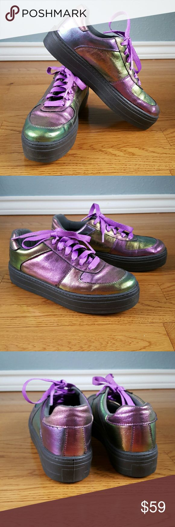 ASOS Shimmery Purple/Green Platform Sneakers Awesome ASOS brand iridescent beetle colored tennis shoes. Black rubber platform soles and purple laces. Excellent pre-owned condition. Only worn a couple of times. Vegan, non-leather. UK 6, Euro 39. I think they are a US women's size 8. KEYWORDS: UNIF, YRU, Nasty Gal, Dolls Kill, Jeffrey Campbell, Rave. ASOS Shoes Sneakers