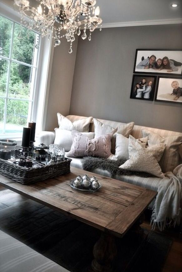 Love it. Gray walls. Off white couch. Dark wood table. & lots of pillowsssss :)