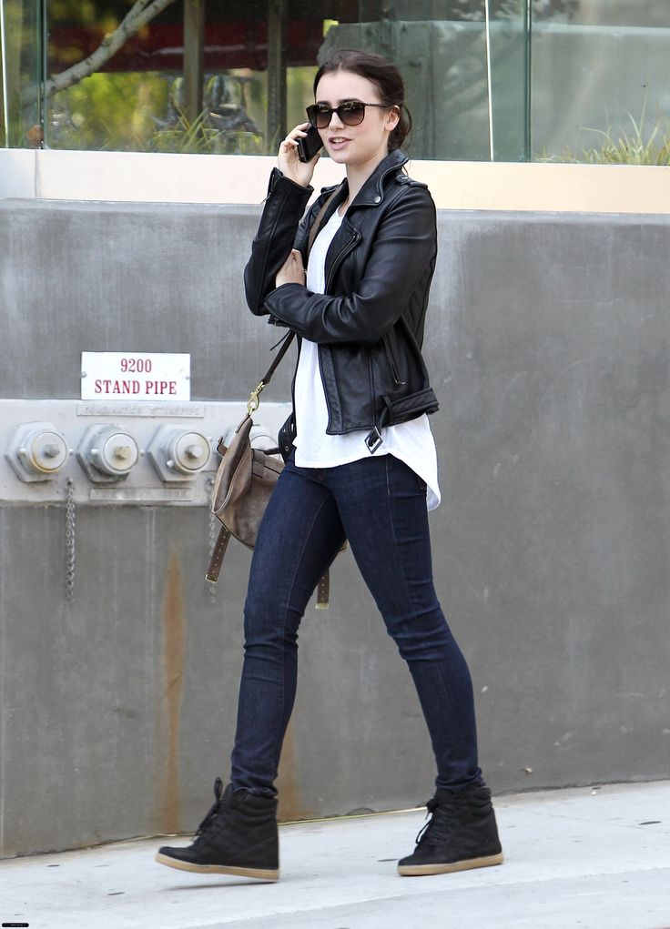 Lily Collins. Usually I hate wedge sneakers but this looks chic and pulled together