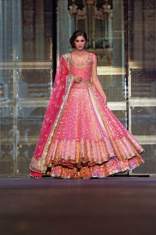 stunning pink umbrella outfit!  Salmon colored outfit for a south Asian bride
