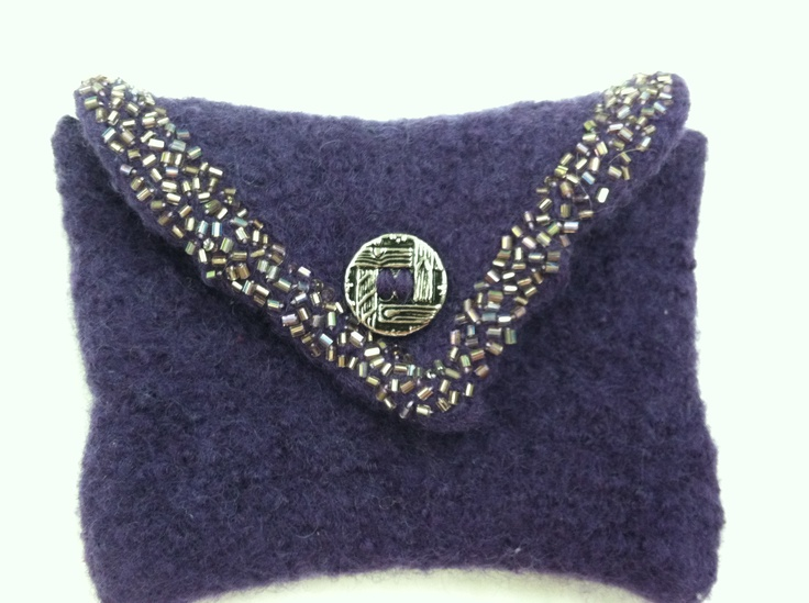 cute change purse.  all handmade, felted and embroidered with delica beads and closed with an antique button.  2.5 x 3.5 ""
