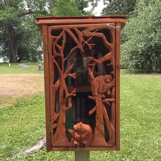 Wendy Ness. Onamia, MN. I belong to the Onamia Early Childhood Coalition and we sponsor the eight other Little Libraries in our town. My kids gave me this Library for a Christmas present. It has a carving of two bears sitting in a tree and handmade wooden shingles.