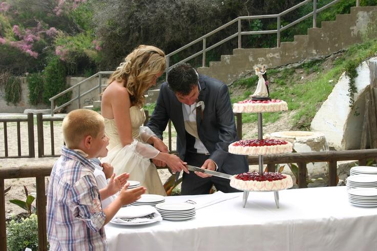 Cutting the Wedding Cake at Luna Beach Club.