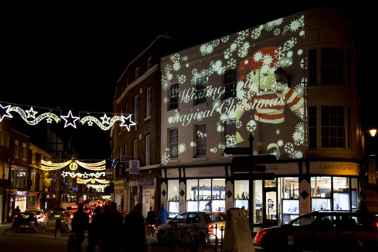 Light artist Andy McKeown's Christmas projection on the front of Fabricius Green, Shrewsbury.