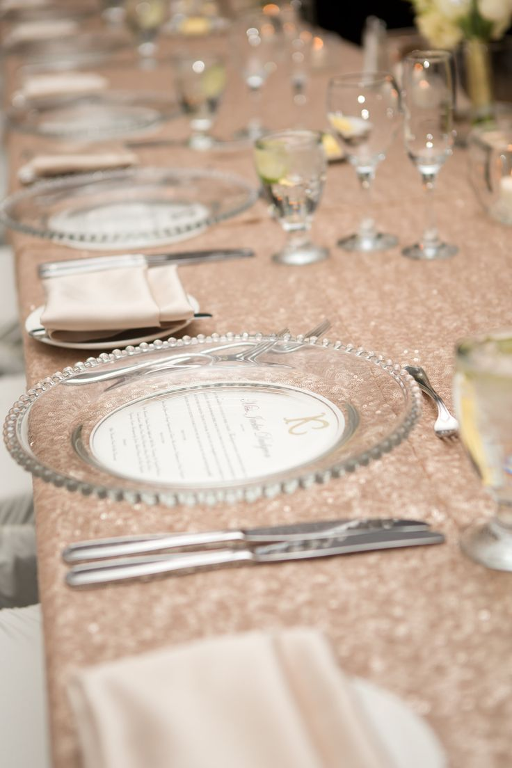 Photo: @amarie_photo || Champagne Glitter Table Linens, Glass Charger Plates, Delta Winnipeg Hotel Wedding New Years Eve