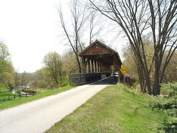 The Reed City covered footbridge is an attractive addition to the White Pines Trail Linear State Park. It was built in 2000. The White Pines Trails is 92 miles in length, and is located in southwestern Osceola County.