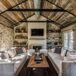 rustic luxe living room farmhouse with deep sofa resin wall sculptures