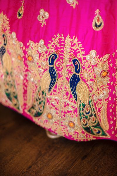 Bridal Details - Peacock Blue, Green and Gold Caricature as a Lehenga Border | WedMeGood #wedmegood #lehenga #indianbride #indianwedding #peacock #caricature #embroidery #bridaldetails