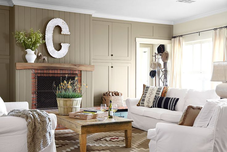 "To create symmetry in the living room, the owner of this Texas ranch hired a contractor to relocate the corner hearth with a new one, centered on the wall opposite her open kitchen. Built-in cabinetry on either side of the fireplace reinforces the sense of balance. The metal ""C"" above the mantel came from a garden store in nearby Waxahachie, Texas.   - CountryLiving.com"