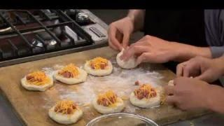 homemade hot pockets using pre-made refrigerated dough.  this is a ham and cheese recipe, but try different varieties.  meal or snack, frugal, quick, easy.     lj