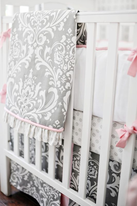 Light gray and pale pink damask, not just for nursery but for anything! Gorgeous...i think i want a girl really bad.  keeping my fingers crossed ;)