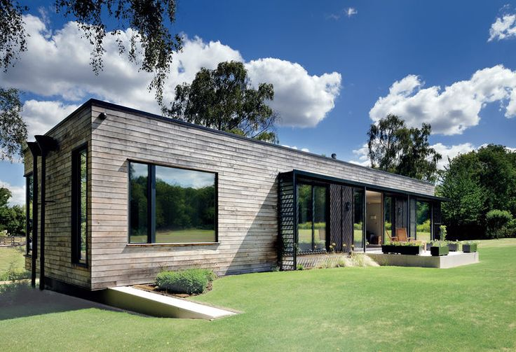 Modern prefab english mobile home with chesnut clad facade