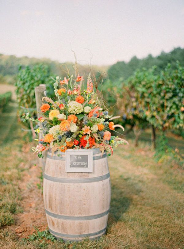Wine barrel floral arrangement by @Holly Chapple http://www.hollychappleflowers.com/
