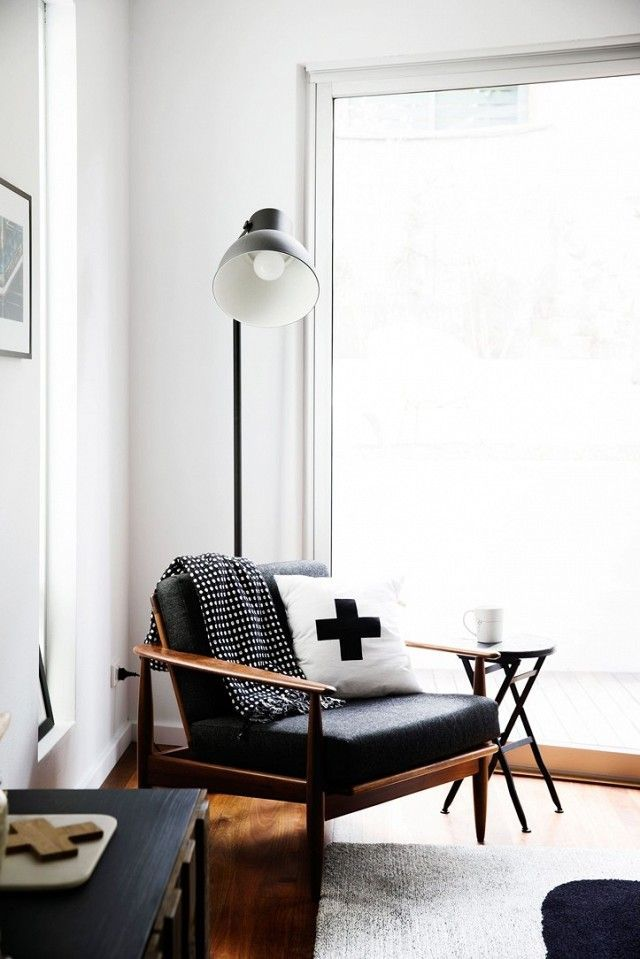 This simple yet stylish reading nook beckons every eager bookworm to its corner. This large-scale floor lamp adds a touch of 1940s industrial feel to any home. Can't you just see yourself with a...