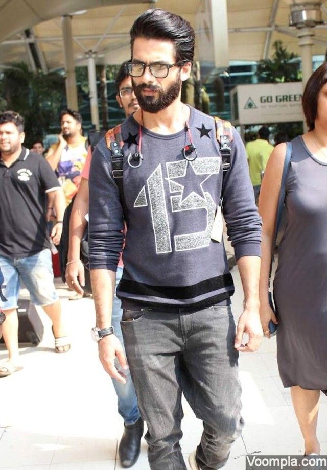 Shahid Kapoor spotted at the airport looking super cool in a sweatshirt, jeans, heavy beard, slick hair and a chic pair of glasses with a rectangle frame. via Voompla.com