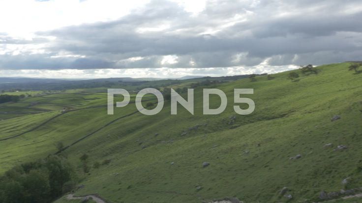4K View From Peak of Malham Cove Cliff Lime Stone Rocks Trees Countryside - Stock Footage | by RyanJonesFilms