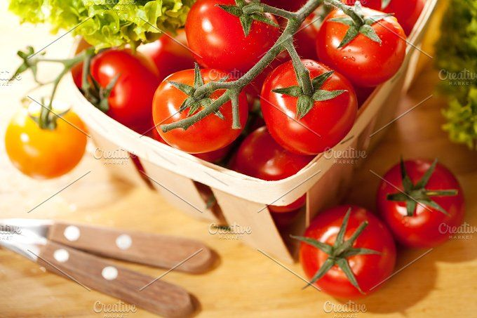 Tomatoes and salad in  wooden basket by Olha Klein on @creativemarket Food Photography