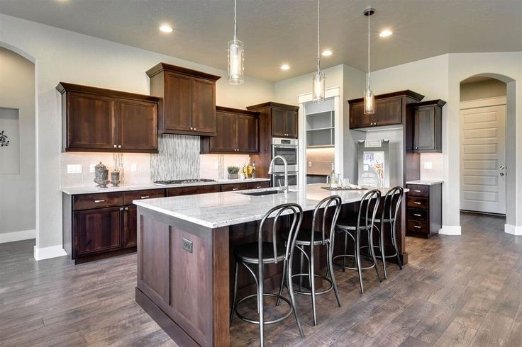 """For sale: $476,900. The """"Teton""""  On the Water! Our most popular 3.5 bath Single Level by Sunrise Homes - now with 42' RV Bay! This New Age Lifestyle plan appeals to people of all ages - spacious Designer Island Kitchen opens to oversize Dining & Great Rm w/Beamed Ceilings/full wall stone fireplace - complete w/Chefs Walk-in appliance Pantry! Perfect plan for extended family - generous BdRm sizes, each w/their own bath-Everyone will appreciate the Private ..."""