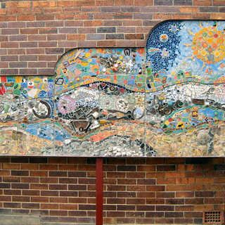 To create this extraordinary piece of street art, Stanthorpe locals contributed bits of memorabilia like badges, bottle caps, even a well worn horse shoe. all linked to the history and memories of the Granite Belt area in Queensland where Stanthorpe is located.