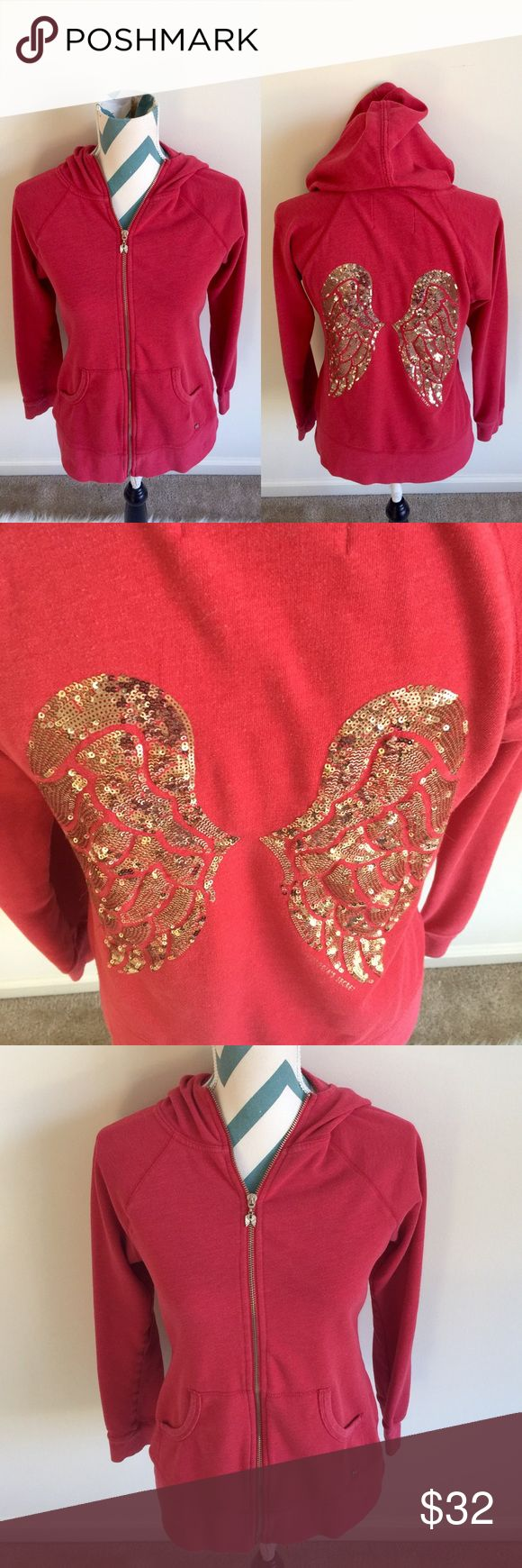 VS Angels Sweatshirt Beautiful red zip up sweatshirt with gold sequin angel wings on the back. Pockets in the front with angel wing zipper pull. No flaws! Victoria's Secret Tops Sweatshirts & Hoodies