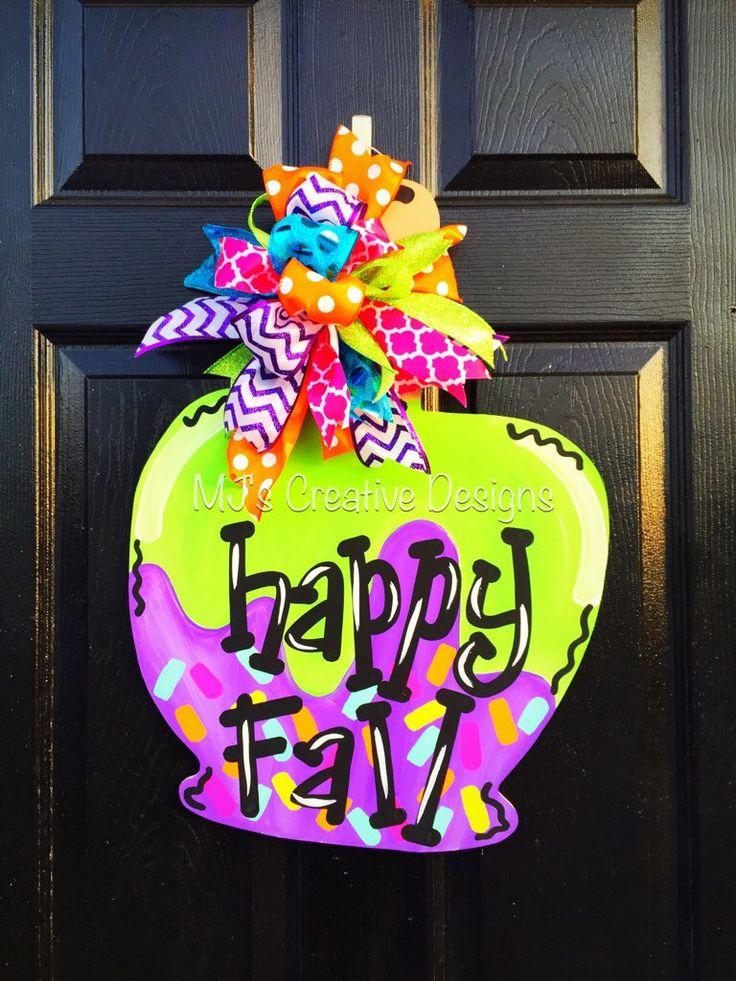 Fall Door Hanger- Candy Apple Door Hanger, Happy Fall Door Hanger, Halloween Door Hanger, Colorful Door Hanger, Wooden Apple Door Hanger by MJCreativeDesign on Etsy https://www.etsy.com/listing/399833199/fall-door-hanger-candy-apple-door-hanger