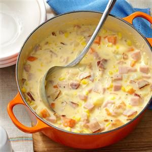 Cheesy Ham Chowder Recipe -This recipe is one of my family's favorites. The chowder is chock-full of potatoes, ham and carrots. I like to make this comforting soup at least once or twice a month during the fall and winter. —Jennifer Trenhaile, Emerson, Nebraska