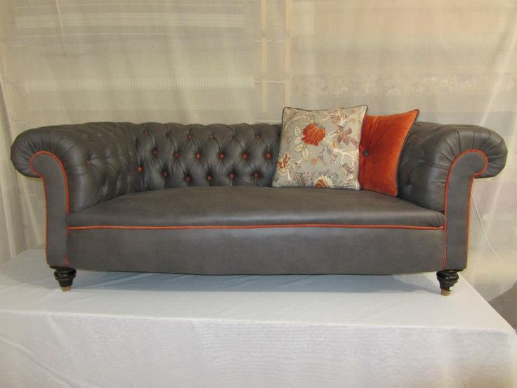 Chesterfield in Season Grey with Rogers Orange & Cushions in Lanka Orange & Rogers Orange by Noel McEntee By Design