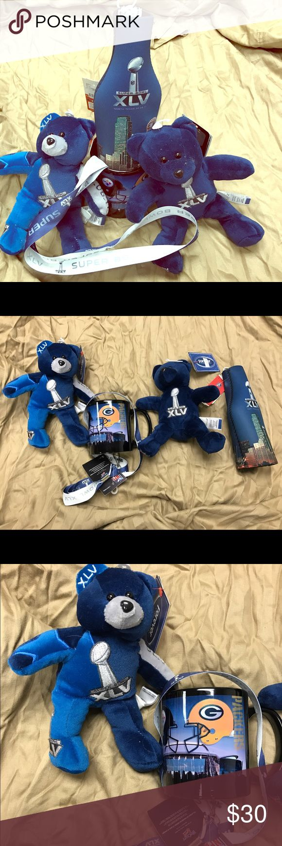Super Bowl 45 accessories! Super Bowl XLV! 2 beanie baby type bears, one lanyard & one coffee mug, all new with tags! Also a white super bowl hat with blue embroidery (used condition) included if you want. Celebrate that great Packers win!! Other