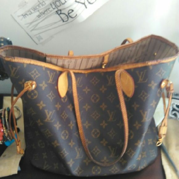 Louis Vuitton  Neverful MM Was used a fashionable diaper bag . As you can see its has wear tear on it.  However it's still a great tote for the first time Louis lover. Louis Vuitton Bags Totes