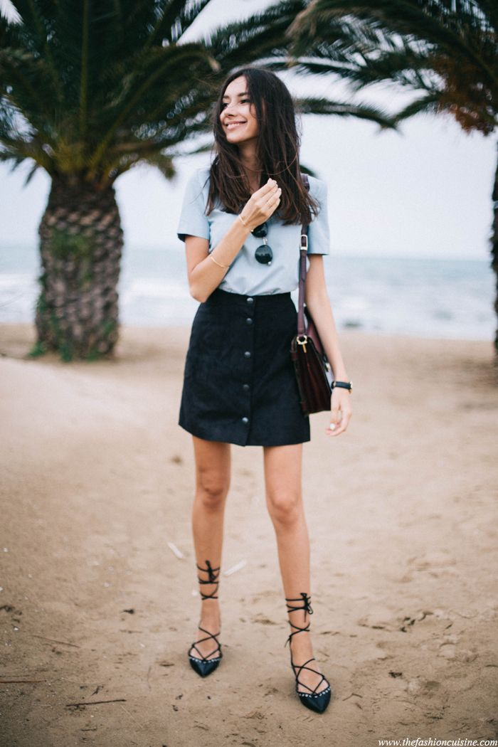 Fashion blogger wearing black button through skirt with blue top and lace up ballerina flats