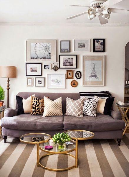 Apartamento de soltera. alfombra rayas. pared con cuadros. ventilador. mesa cristal