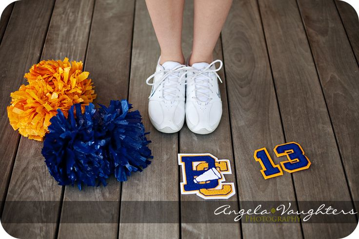 senior cheer pic.  I like it, but maybe with both sets of poms instead of the patches since hers are sewn onto her jacket.