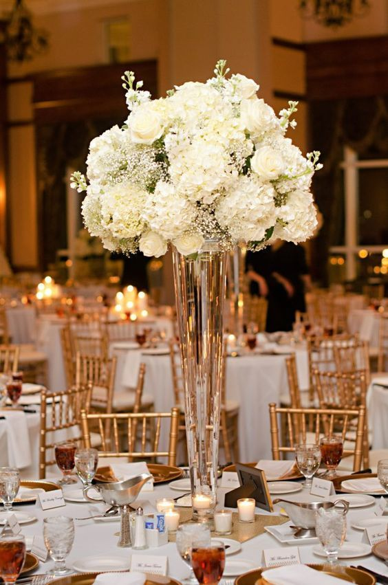 White Hydrangeas, roses, babies Breathe Tall Floral Arrangements for Weddings / http://www.himisspuff.com/beautiful-hydrangeas-wedding-ideas/