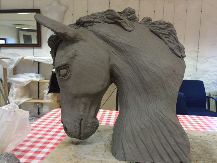 Horse head in clay