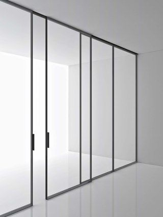 Greene. Manufacturer: Boffi. Designer: Piero Lissoni. Self-bearing system of sliding or fixed doors from floor to ceiling, with frame in anodised aluminium, finish matt black and transparent glass in a variety of colours. Doors can be in single or with multiple doors version.