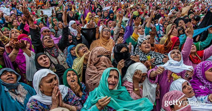Kashmiri Muslim women pray as a head priest displays the holy relic believed to be a whisker from the beard of the Prophet Mohammed on the occasion of the Muslim festival Mehraj-u-Alam, which marks ascension day, the journey from earth to heavens of the Prophet Mohammed, at the Hazratbal Shrine on May 5, 2016 in Srinagar, the summer capital of Indian administered Kashmir, India.  #2016InFocus