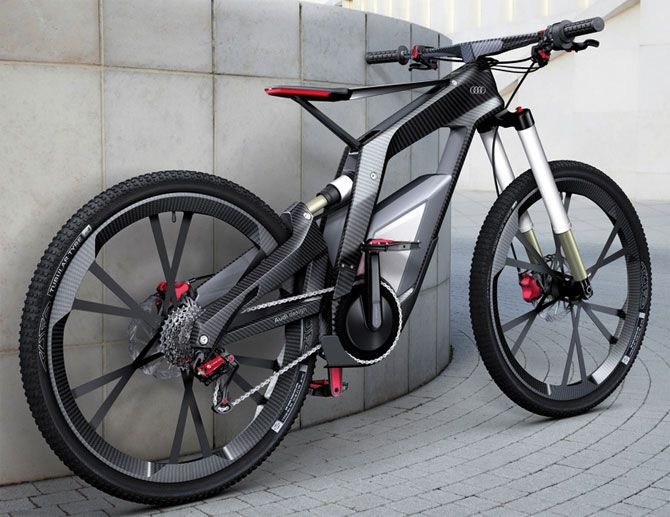 audis performance electric mountain bike complete with a carbon fibre frame smartphone connectivity and the ability to perform wheelies with the
