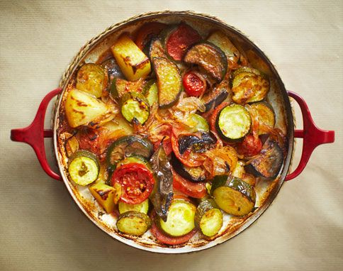 Briam ( Greek medley of baked vegetables); with a bit of grilled chicken and you've got a perfect meal for an easy night with friends.