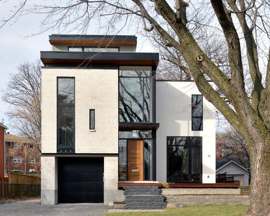 Exterior Design, Astonishing Modern And Minimalist House Facade With Modern Black Garage Doors Also Beige And White Wall Color And Huge Contemporary Windows Design Also Big Tree In The Garden: Amazing And Cool Modern Garage Door For Your Garage