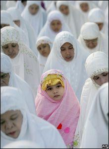 A Muslim girl takes part in a morning prayer marking the start Eid al-Fitr in Jakarta, Indonesia