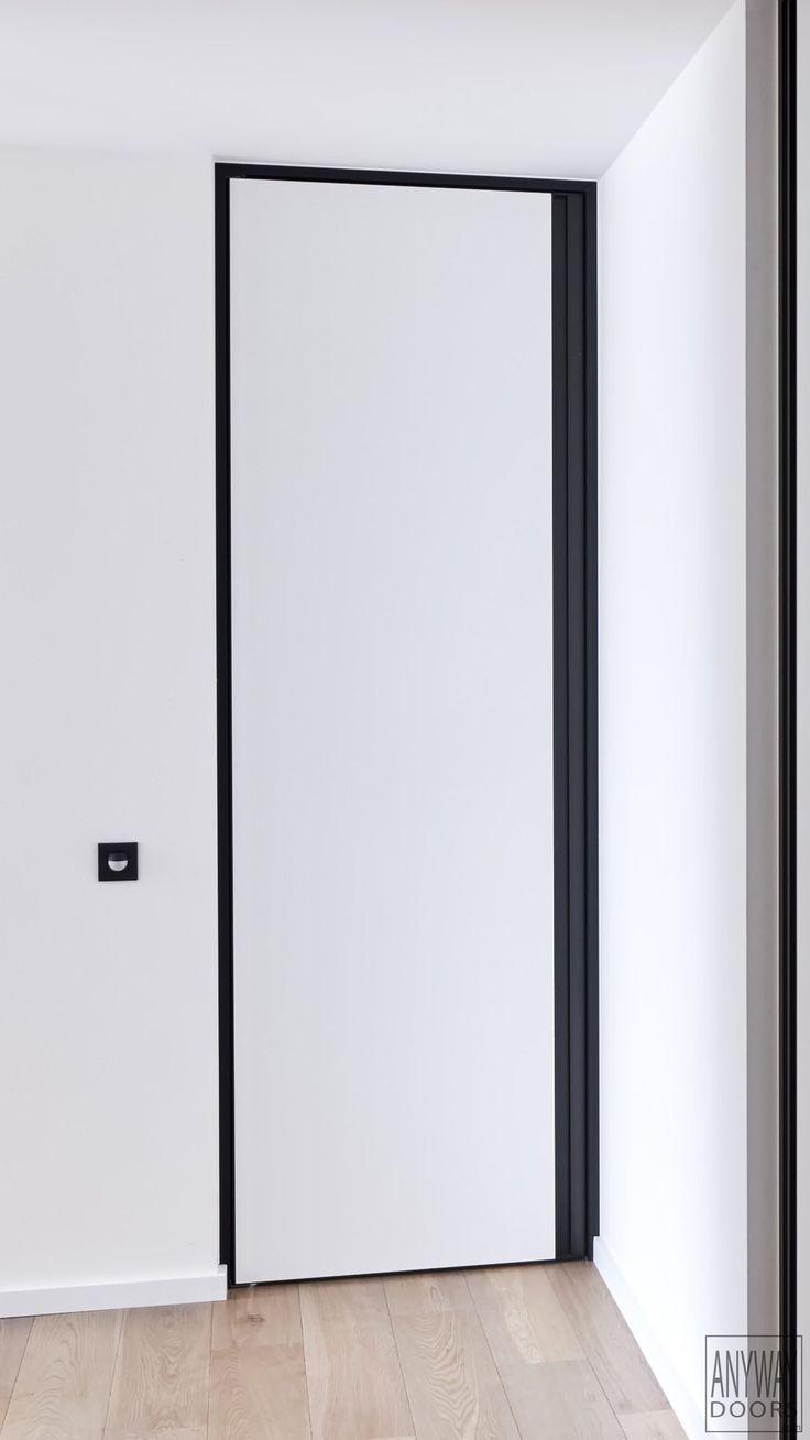 Modern white interior doors - White Interior Door With A Black Door Frame And Built In Handle Anywaydoors