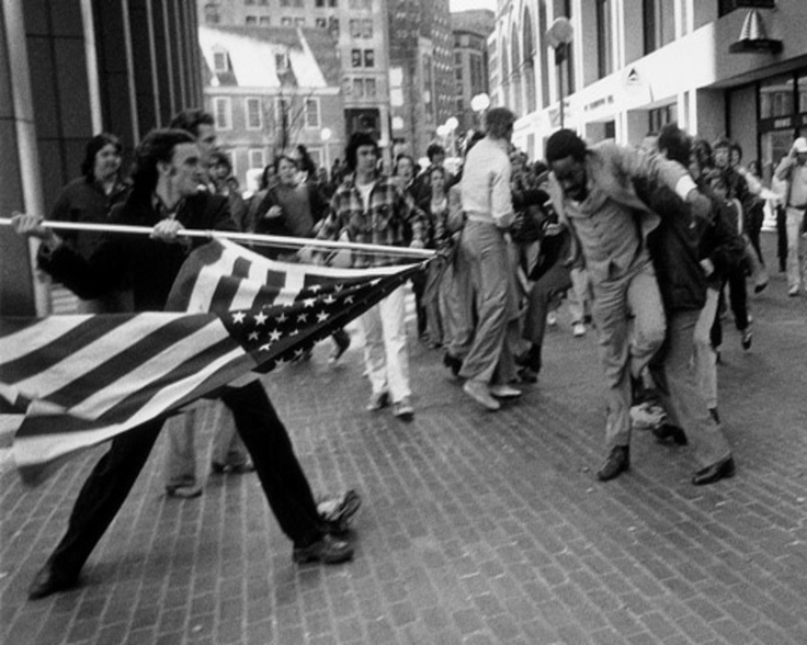 Pulitzer Prize Photography 1977: Stanley Forman, Boston Herald American - youth using the flag as a lance in street disorders