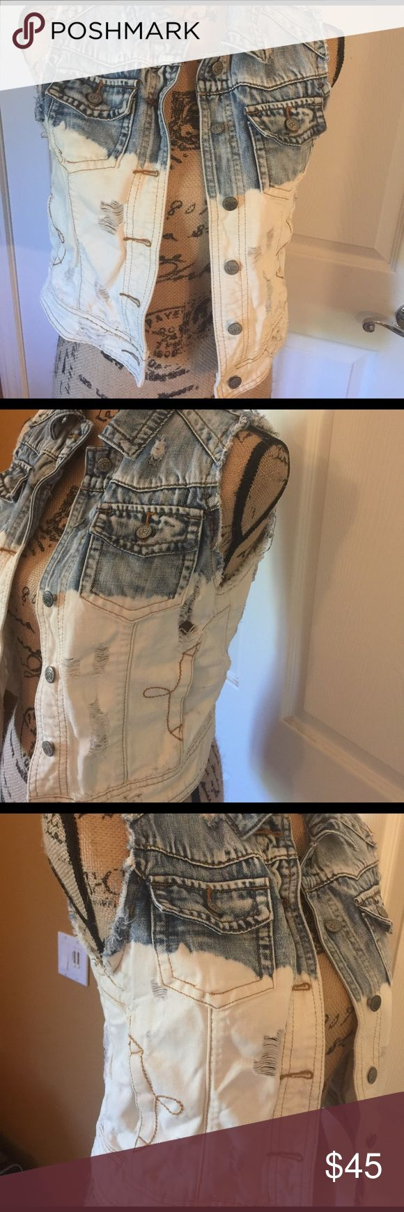 Ripped style 2 tone Jean vest by Lost Jean vest that has rips all over it. that's all the rage right now. Faded blue and white Jean vest. 2 breast pockets and side pockets. Looks very cute on with everything. Very stylish right not. Cute with ripped jeans. Other