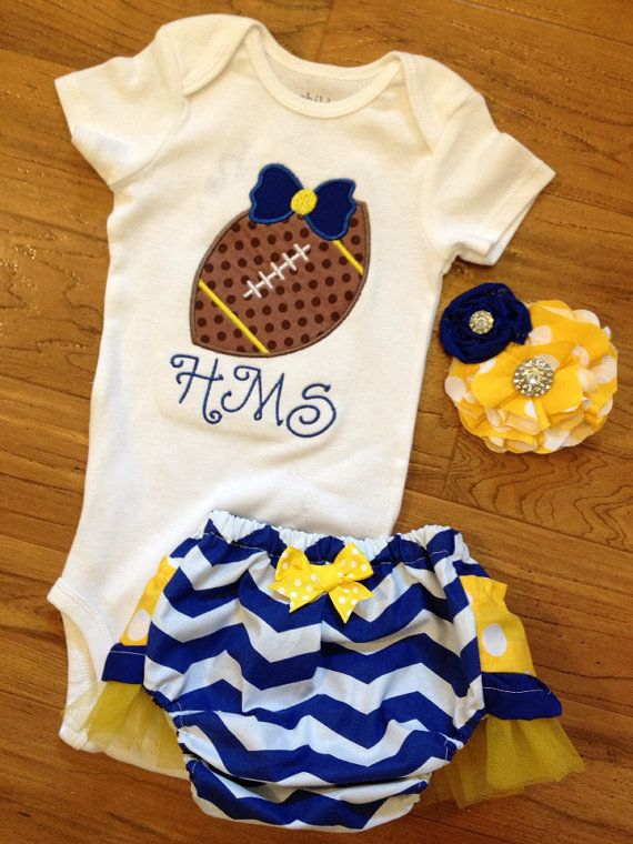 Baby girl football team spirit outfit by PeacebyPiece01 on Etsy, $50.00. Could probably get pieces separately for cheaper but it's the right colors too!