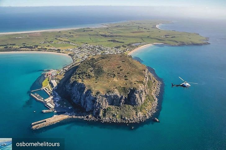 This amazing shot captured by @osbornehelitours showcases the dramatic rock formation called the 'Nut'. Soaring High over some of the worlds most picturesque coastlines.