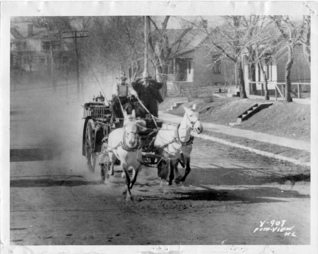 A horse-drawn fire wagon running on Westport Road near Pennsylvania Avenue in preparation for the fire department's trip to Paris in 1900 | A century of safety: Historical photos of Kansas City's police and fire departments | The Kansas City Star #KCMO