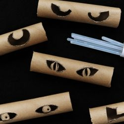 Quick and easy Halloween decoration for indoors or out! Cut eye designs into paper towel rolls. Insert glow sticks to make spooky 'glow in the dark' eyes to hide in trees or bushes!