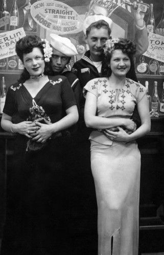 1940s Formal Dresses, Prom Dresses, Cocktail Dresses History.. Girls out for a night with their sailor men wearing long cocktail dresses.  #1940sfahsion