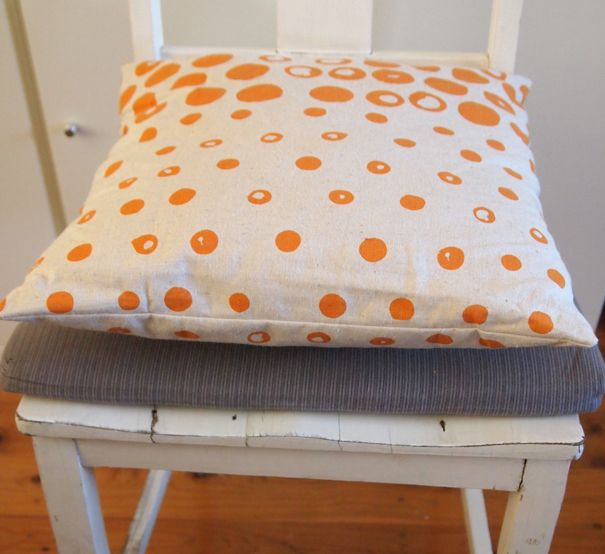 Dip Dotted Cushion Cover.  Orange on Natural.